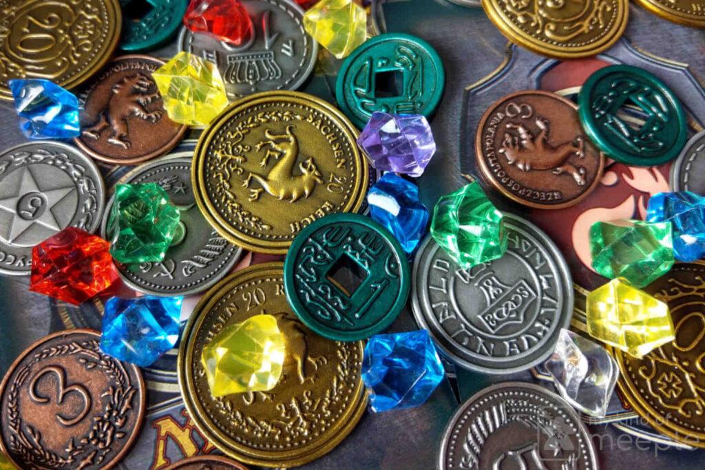 Recursos dinero monedas gemas juego de mesa